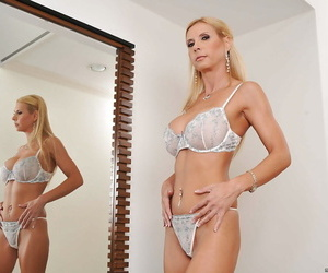 Blonde MILF Brooke Tyler taking off her lingerie and teasing her cunt