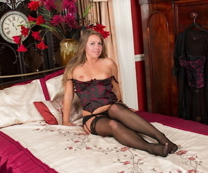 Chubby mature woman Leo Star modelling black lingerie and masturbating
