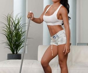 Young brunette maid Amia Miley unleashing big boobs from white T-shirt