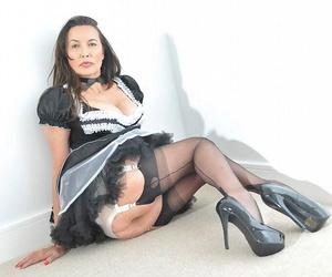 Busty mature maid in uniform and black stockings flashing hot panty upskirt