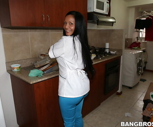 Brunette maid Casandra shows off her ass in a tight uniform