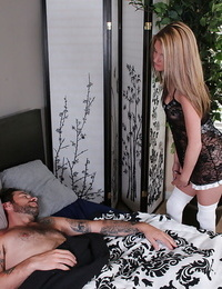 Horny maid in stockings giving a handjob to a guy while hes sleeping