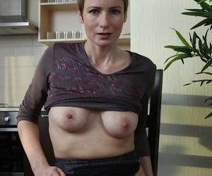Gargantuan short haired older unsparing Sweet Nensy revealing grown up breasts