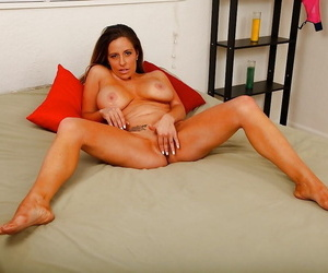 Older Latina woman Sienna Lopez unleashing nice tits before finger fucking
