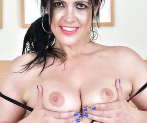 European mature angel Montse Swinger demonstrates shaved pussy and masturbates