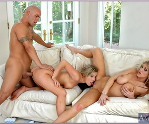Busty blondes Eve Laurence and Harmony fucking fervently in a gangbang