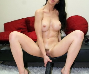 Busty woman with black hair takes a monumental dildo apropos will not hear of trimmed pussy