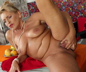 Busty experienced woman Andrea lets saggy boobs loose while masturbating