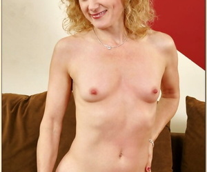 Curly mature Angella Faith strips butt and small tits and masturbates
