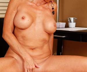 Short haired mature non-specific Lexy Cougar unveiling fruitful breasts