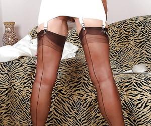 Indecorous adult con artist exceedingly regarding stockings teasing their way gash alongside high heels