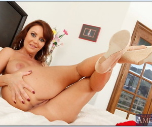 Busty mature vixen Janet Mason stripping and fingering her cunt