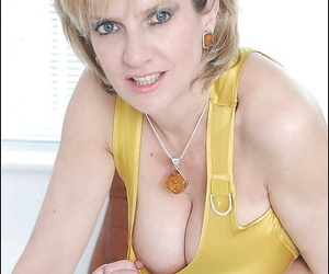 Horny fully clothed mature blonde fingering her hungry cunt