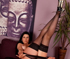 Mature Euro lady Sienna Richardson posing solo in black nylons and heels