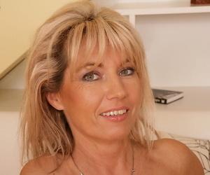 Mature lady Janet Darling spreading hairy vagina and masturbating