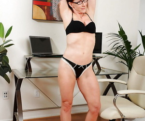 Tempting mature in glasses Catherine Desade using a dildo to play with her slit