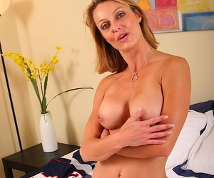 Bosomy blonde mature vixen undressing and exposing her slit in close up