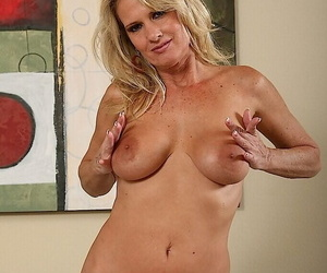Naughty mature blonde in black stockings revealing her sexy curves