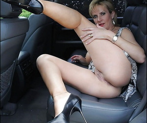 Lusty mature blonde demonstrates her goods posing on the backseat