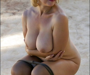 Mature wealthy everywhere pantyhose squeezing her huge melons and masturbating outdoor
