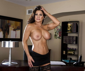 Juggy lady in stockings Teri Weigel undressing and posing on her office desk