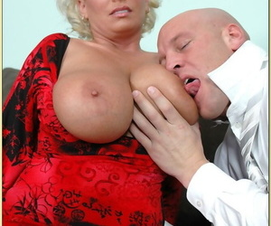 Chubby mature Claudia Marie using big tits to please a huge cock