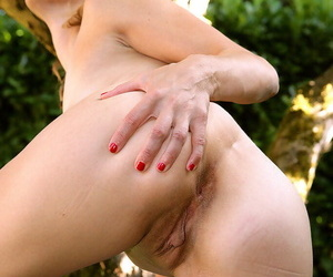 Mature lady spreading her shaved pussy outdoor and passionately rubbing her pink