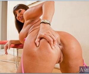 Mature asian seductress Ava Devine posing topless in nylon stockings