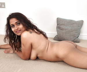 Dirty-minded mature lassie undressing and exposing their way shaggy twat