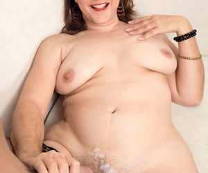 Middle-aged lady Gia Marie tugs on a cock until her cunt is jizz covered