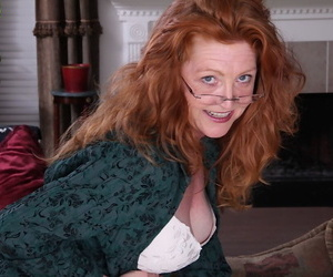 Redhead mature gal approximately glasses annd stockings undressing plus exposing their way goods