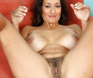 Big lead balloon mature vixen taking off her lingerie with the addition of brushing her hairy shrub