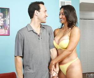 Perky mature lassie with amazing jugs seduces a hung guy to please her cunt