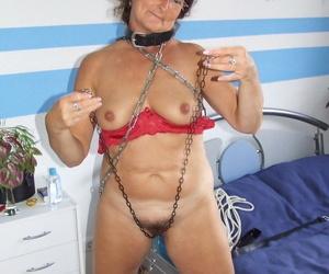 Wild short haired granny Gabriele masturbating in alone BDSM action