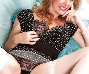 Delightsome mature revealing big tits from hot lingerie and fingering her slit