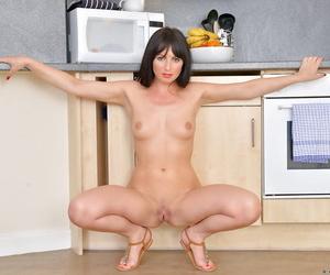 Brunette mature babe Roxanne has her ass filmed while undressing