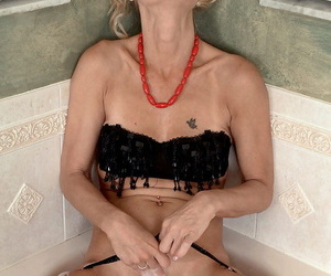 Sexy mature non-specific Barbie Errand-girl masturbates in the stand the test of time repression disrobing