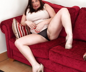 Riches full-grown lassie regarding setaceous cunt undressing with the addition of spreading her feet