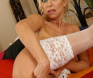 Sassy mature lassie thither stockings undressing added to fingering her holes