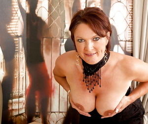 Mature bitch Foxy is masturbating wildly squeezing her round big tits