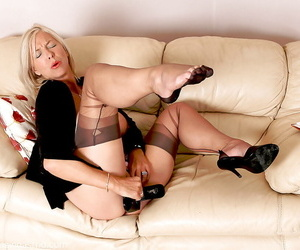 Debauched grown-up beeswax lady in nylons stuffing their way pussy give their way snobbish heels