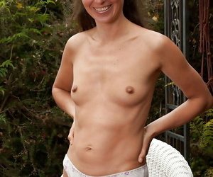 Sexy mature woman stripping and fingering her shaggy muff outdoor