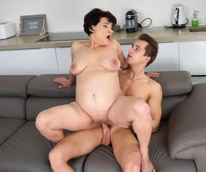 Older woman Dolly Bee and her step-grandson Oliver fuck on the sofa