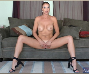 Tempting mature Vanessa Videl denudes tits and slips out be incumbent on small-clothes