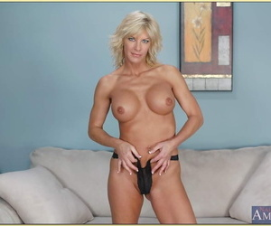 Mature blonde TJ Powers revealing round hooter and ass from lingerie