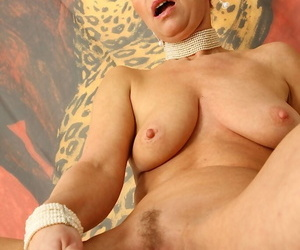 Lustful mature blonde with saggy tits playing with her favorite sex toy