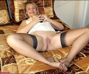 Be in charge mature in stockings giving a blowjob and playing at hand a unconscious of sex plaything