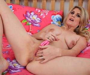 Dirty blond female Ashleigh McKenzie attends to her wide open pink pussy