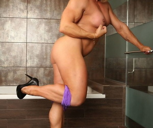 Muscled female bodybuilder Emery Miller with tight tits and big pierced clit