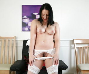 Mature lady Amber Lustfull stripping and fingering her pink twat